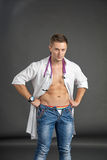 Portrait of a sexy young man in doctor costume Stock Images