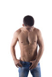 Portrait of sexy young man in jeans Royalty Free Stock Image