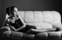 Portrait of sexy young model on sofa Stock Photo
