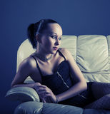Portrait of sexy young model on sofa Stock Photos