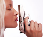 Portrait of sexy young woman with gun. Portrait of young sexy woman holding her gun, focus on her lips, nose and gun Royalty Free Stock Photos