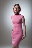 Portrait of sexy young woman in pink dress Royalty Free Stock Image