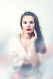 Portrait of a sexy young woman with red lips Stock Images