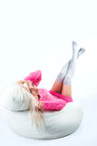 Portrait of a sexy young woman sitting on pouf Royalty Free Stock Photos