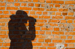Portrait shadow. Portrait shade on a brick wall Royalty Free Stock Image