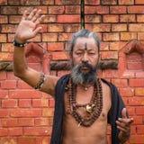 Portrait of Shaiva sadhu, holy man in Pashupatinath Temple, Kathmandu. Nepal Royalty Free Stock Photos