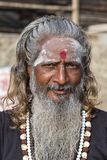 Portrait of Shaiva sadhu, holy man in Varanasi, India. VARANASI, INDIA - JANUARY 25, 2017 : Portrait of Shaiva sadhu, holy man on the ghats of the Ganges river Stock Photos