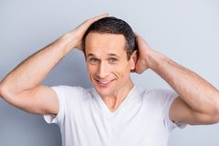 Portrait of shaven, experienced, neat, trendy, brunet, positive stock photos
