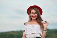 Portrait shiny positive girl with irresistible smile. Portrait awesome shiny positive girl with irresistible smile, wearing free white blouse, naked shoulders stock image