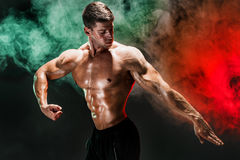 Portrait of shirtless bodybuilder. Muscular man posing in studio. Royalty Free Stock Photography