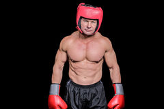 Portrait of shirtless man with boxing headgear and gloves Stock Images