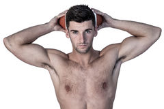 Portrait of a shirtless man holding ball over head Royalty Free Stock Photography