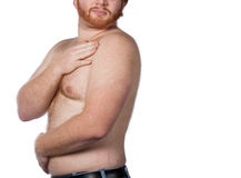 A portrait of a shirtless man  on a white background. He has red hair & a beard Stock Images