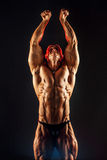 Portrait of shirtless muscular man with arm up Royalty Free Stock Photography