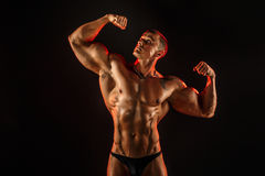 Portrait of shirtless muscular man with arm up Stock Photography