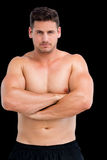Portrait of a shirtless muscular man with arms crossed Royalty Free Stock Photography