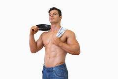 Portrait of a shirtless muscular man holding frying pan Stock Photography