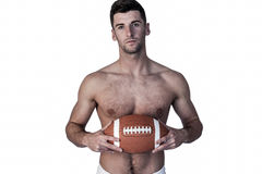 Portrait of shirtless rugby player with the ball Royalty Free Stock Photos