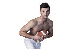 Portrait of shirtless rugby player posing with the ball Royalty Free Stock Image