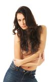 Portrait of a shirtless woman alluring in jeans Royalty Free Stock Photography