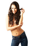 Portrait of a shirtless woman alluring in jeans Stock Image