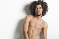 Portrait of a shirtless young man over white background Stock Image