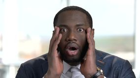 Portrait of shocked african american in suit. stock video footage