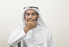 Portrait of a shocked Arabian man covering his mouth , Arabian g. Uy shocked Royalty Free Stock Photos