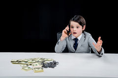 Portrait of shocked boy playing businessman and talking on smartphone Royalty Free Stock Photography