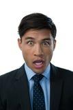 Portrait of shocked businessman Stock Photos