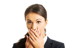 Portrait of shocked businesswoman covering mouth Royalty Free Stock Photo