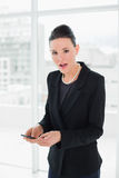 Portrait of a shocked elegant young businesswoman with a mobile phone Royalty Free Stock Photo