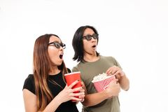Portrait of a shocked excited asian couple in 3d glasses Stock Image
