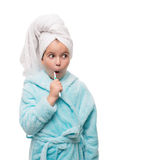 Portrait of shocked little girl wearing bathrobe with towel on h Royalty Free Stock Photos