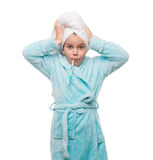 Portrait of shocked little girl wearing bathrobe with towel on h Stock Image