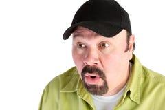 Portrait of shocked man in baseball cap Stock Photography