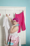 Portrait of a shocked plus-size woman drying clothes Royalty Free Stock Photo