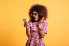 Portrait of a shocked surprised afro american woman stock images