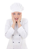 Portrait of shocked woman in chef uniform isolated on white Stock Images