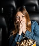 Portrait Of Shocked Woman At Cinema Theater Stock Photos