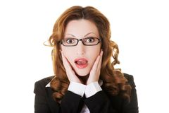 Portrait of shocked woman looking at the camera Stock Images