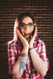 Portrait of shocked woman in spectacles. Against brick wall Royalty Free Stock Photo