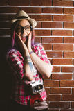 Portrait of shocked woman in spectacles. Against brick wall Stock Photo