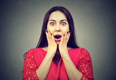 Portrait of a shocked woman royalty free stock photography