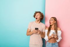 Portrait of a shocked young couple stock photos