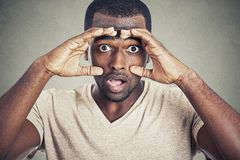 Portrait shocked young man  on gray wall background Stock Photography