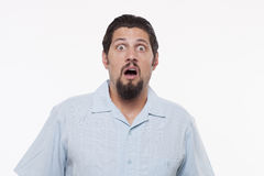 Portrait of a shocked young man with mouth open Stock Photo