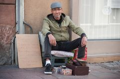 Portrait of Shoe shine in the street Royalty Free Stock Photo