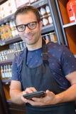 Portrait shopkeeper holding calculator Stock Photos