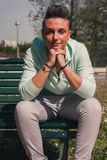 Portrait of a short hair girl sitting on bench Stock Image